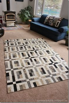City Slicker #2.  Both this quilt and the one on the couch are lovely designs for neutrals.
