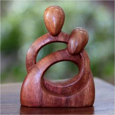 Bring the beauty of handcrafted wooden sculpture to your space with this stylized wooden sculpture from NOVICA. Featuring two intertwined subjects carved from suar wood, this stunning piece offers easy elegance for your display cabinet or end table.