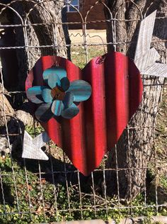 A personal favorite from my Etsy shop https://www.etsy.com/listing/265863361/red-corrugated-tin-heart-with-wooden