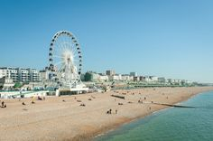 Photo about Clear blue sky over Brighton beach, UK and the tourist attractions of Madeira Drive. Image of town, summer, beach - 24910508 Mykonos, Spring Break, Summer, Albion Hotel, Brighton Museum, New York Attractions, Royal Pavilion, Portugal, Florida