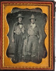 """Quantrill's Guerillas: A Spectacular Quarter-Plate Daguerreotype of Will Bassham and an Unidentified Man.In """"uniforms"""" of brown tunic shirts, with sidearms and non-military issue rifles of """"Kentucky rifle"""" style. Bassham wears a large sheathed fighting knife on his belt. A rare and important image in its original leatherette case. (Continued in comments.)"""