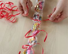 Candy Leis. Made with Saran Wrap and ribbons.