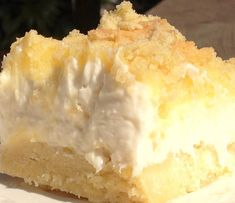 Lemon Cheesecake Delight. Fresh, lemon curd topping, No Bake-Cheesecake filling, with a Lemon cookie crust.