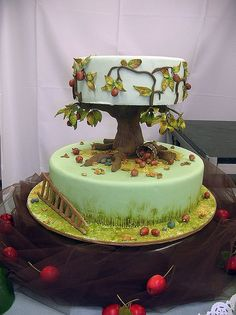 This is my favorite outdoors-themed cake I've found. I'd make it a weeping willow instead to incorporate the top cake better.