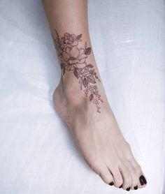 Delicate floral ankle tattoo by Irene Bogachuk  | feminine tattooing (@irenebogachuk)