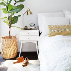 This sunny vignette by @newdarlings makes me happy. Were featuring that nightstand on the blog for $150 today. Featured in @dominomag by @michaelwiltbank #CopyCatChic