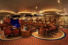 For Koningsdam, the iconic Queen's Lounge has been completely reimagined as an elegant theater and entertainment venue that spans two floors.