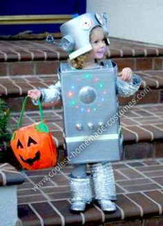 """Homemade Silver Robot Halloween Costume: Our two-year-old daughter requested to be a """"fancy silver robot"""" for Halloween. Her cardboard box costume, reminiscent of robots her dad made as a child. Robot Halloween Costume, Sibling Halloween Costumes, Robot Costumes, Kids Costumes Boys, Sibling Costume, Homemade Robot, Homemade Halloween, Holidays Halloween, Halloween Kids"""