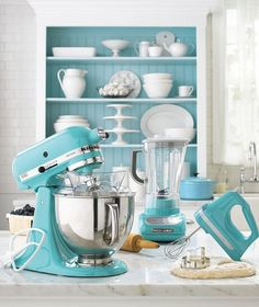 not that the teal kitchen gadgets are cute...but look at the display in the back! LOVE