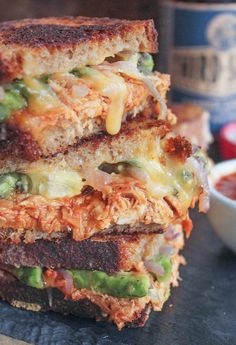 Barbecue Chicken Grilled Cheese. Tangy BBQ chicken, creamy avocado, sautéed red onions, cilantro and lots of melty cheese!