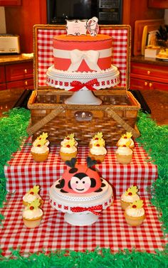 Maybe put the cupcake stand in the picnic basket....  just a thought....