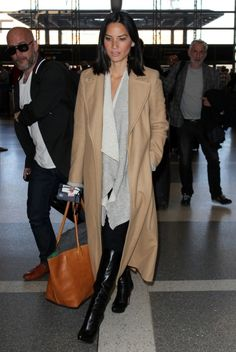 Olivia Munn arriving at LAX airport in Los Angeles, CA, for an international flight.