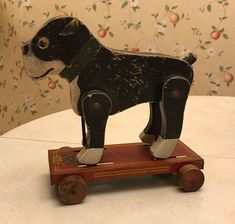 Vintage and well used showing surface wear and scratches, loss of paint, small chips in wood, one wooden wheel has split in half. Antique Toys, Vintage Toys, Vintage Antiques, Pull Toy, Toy Collector, Toy Sale, Dog Walking, Tin, The Past