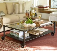 Similar Look of the Tanner table, but with the ability to move around if needed to create more space for a party.  Robert Coffee Table | Pottery Barn