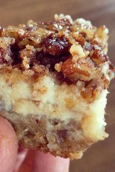 Pecan Cheesecake Squares - Tee's Tasty Treats - shortbread layer : 1 c all-purpose flour, c firmly packed light brown sugar, c butter softened, c finely chopped pecans. Cheesecake layer: 2 pkgs cream cheese softened c sugar, 1 13 Desserts, Delicious Desserts, Dessert Recipes, Yummy Food, Layered Desserts, Cookbook Recipes, Cookie Recipes, Pecan Cheesecake Squares, Cheesecake Recipes
