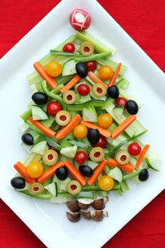 Christmas Tree Relish Tray | Tasty Kitchen: A Happy Recipe Community! Not too hard to make. I put dip in a small, star shaped foil pan...and placed it at the top of the tree (instead of making a radish rose tree-topper).