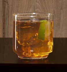 The Perfect Storm 2 parts Sailor Jerry spiced rum,  ginger beer,  2 or 3 lime wedges    Use highball or beer glass.  Build in glass over cubed ice & garnish with squeezed lime wedges.    Surprisingly warming and refreshing at the same time.