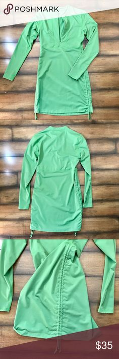 Athleta green long sleeve dress Bright green Athleta long sleeve, half zip, nylon/spandex dress. Very comfortable, perfect for pairing with tights and a weekend hike followed by beers with friends without changing! Athleta Dresses Long Sleeve