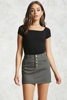 Style Deals - A woven skirt featuring a partial button-down front, slanted front pockets, back patch pockets, and belt loops.