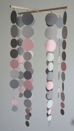 DIY mobile (paint chips) this on a hoop would be a cool lamp shade. would have to make heat resistent though