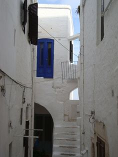 The most interesting thing to see in Ostuni, is the town itself: white buildings unroll on white roads and alleys made of stones. Whatever is part of the town, walls, gutters and gates, is white in Ostuni, and the coloured doors or the hanging clothes seem paintings on a white and unspoilt canvas. Houses are so white in Ostuni, because...