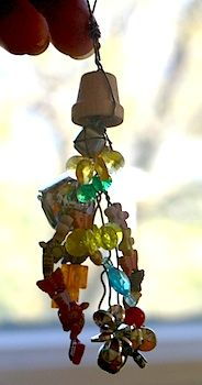 Fairy Windchimes!!!  Love it, what a neat craft to do with my daughter with beads, wire, and gems!!!