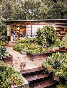 A section of the facade—a cross between a shoji screen and a barn door—slides open. Planter boxes contain edible varieties that fuel Mary's culinary explorations.