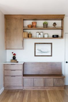 As is common in midcentury houses, the floor plan was open and light on discrete spaces. The designers created this built-in bench and storage area to function as a sort of mud room. Sam, an architect, and Alexi, an interior designer, comprise Los Angeles-based Simo Design.