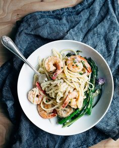 Creamy Asparagus and Shrimp Pasta is a family favorite waiting to happen. This SIMPLE recipe comes together so quickly with an alfredo-style sauce, linguine, asparagus, and shrimp. A few chive blossoms make for a gorgeous and delicious spring dinner.