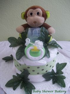 The new jungle themed mini diaper cake is here! This adorable little monkey will be the hit of any baby shower or light up any hospital room! This cake is full of baby essentials, and baby will love snuggling up with their new monkey toy! $25 #Etsy #baby #shower #diaper #cake #jungle #monkey