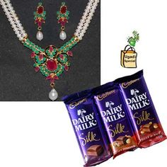 Two String Pearl Set - VFR12 + Cadburys diary Milk Silk chocolates (Fruit & Nut) - 3 bars +Special Ugadi Hamper (1 Big Green Mango + Cheruku Mukkalu + Vaepa Puvvu + Bellam Mukkalu    NOTE: Same day Delivery for Hyderabad and Secunderabad. For other places requires minimum 2 to 3 WORKING DAYS.