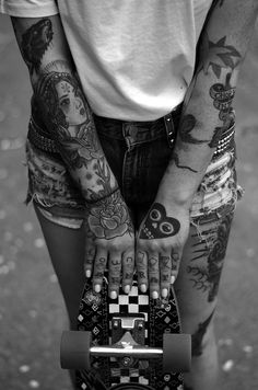 tattooed hands. skateboarding girl.