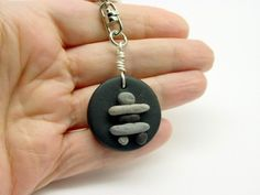 I handcrafted this Inukshuk key chain from my specially mixed batches of polymer clays to simulate beach pebbles Except for the light weight the pebbles look very realistic The black Hat Crafts, Crafts To Do, Thinking Day, Girl Guides, Clay Projects, Pebble Art, Sculpture Art, Washer Necklace, Knitted Hats