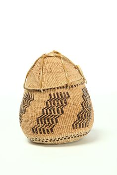 TOBACCO BASKET.  Made by Rebecca James, Northern California, ca. 1983, hazel, spruce and black fig fern. Covered basket with leather ties,