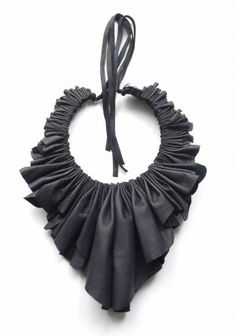 Make this DIY veggie leather necklace with some black cording, excess black faux leather, and a rotary cutter!. Buy the supplies to make this: http://mjtrends.com/pins.php?name=veggie-leather-black-fabric