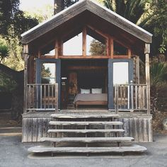 The perfect, bright & rustic guest house. Love these steps + weathered wood + windows everywhere