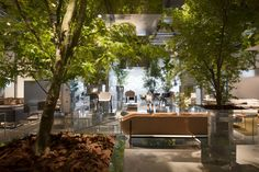 sou fujimoto floats forest above cassina stand at 2014 salone del mobile