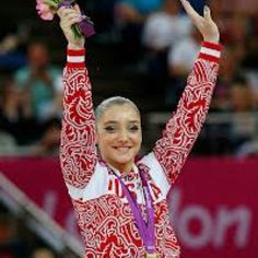 God job aliya! Winning gold today in uneven bars in the Olympic finals in uneven bars..lol she did amazing:)