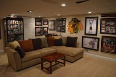 Sports decor for man caves great sports basement sports man cave sports wall hockey man cave Man Cave Garage, Man Cave Basement, Hockey Man Cave, Sports Man Cave, Sports Wall, Hockey Room, Sports Decor, Cave Bar, Man Cave Home Bar