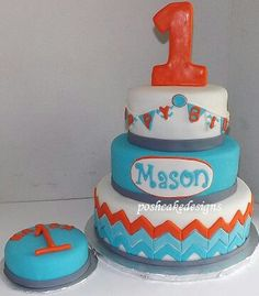 Chevon 1st birthday cake. Boys aqua, orange, grey, white chevron cake. Chevron party idea. Beautiful chevon inspired cake. #poshcakedesigns.com #Birmingham al