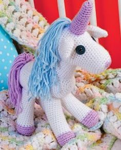 http://translate.google.es/translate?hl=es&sl=en&tl=es&u=http%3A%2F%2Fwww.craftideas.com%2Fprojects%2Fdetails%2F1886%2Fbabys-crocheted-unicorn%23!prettyPhoto