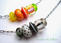Citrus and Tuxedo set of lampwork glass bead sliders by Heather Sellers.
