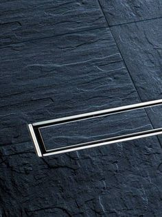 linear invisible shower drain . by kessel