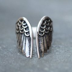 Angel wings ring in solid 925 Sterling Silver, hand carved with love. This beauty is created with time and care, each individual feather, one by one. This beaut
