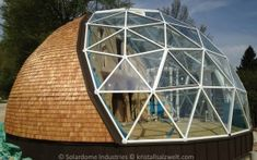 A 10.6m diameter, 5.43m tall part double glazed/part wooden home. Designed to include a mezzanine level.