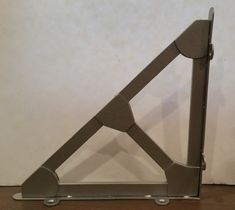 "These Metal truss shelf brackets are hand made from quality ¼"" steel. They are accented with welded on gusset plates, adding additional dimension to the pieces and a look consistent with industrial se"