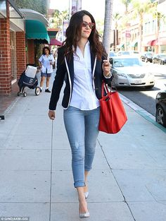 Professional chic: The 27-year-old actress sported a blue blazer over a white button-up bl...