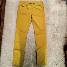 ⭐️SALE⭐️VINCE. Mustard pants Excellent condition. Deep mustard yellow pants made by VINCE. The pants are made out of 66% tencel, 31% cotton, and 3% elastane. They are made in the U.S.A  and come down to your ankles. They are a size 29.                           OFFERS WELCOMED! Vince Jeans Skinny