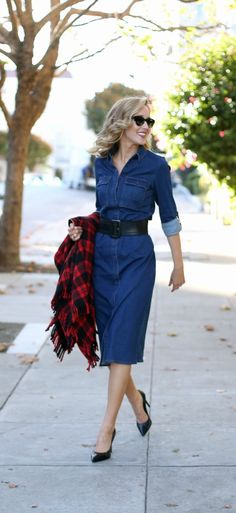denim midi dress belted with wide black leather belt + red and black plaid fringe poncho