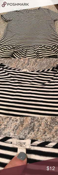 J Crew black & white stripped shirt with peplum. Size medium black and white striped shirt with peplum. 16 inches pit to pit non-stretched and 20 inches total length. J Crew Tops